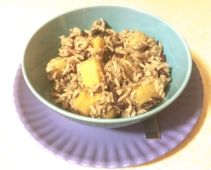Bowl of black beans and pineapple and rice